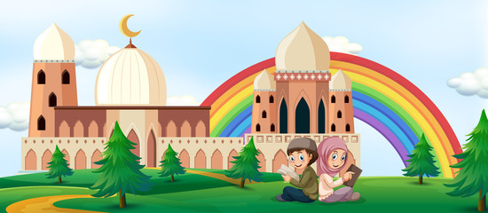 Boy and girl reading book with mosque background