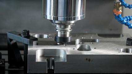 detail is fixed on a moving platform of automatic cutting machine in a shop of factory, close-up of process