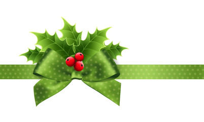 Christmas decoration with holly leaves and bow
