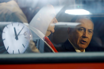Israeli Prime Minister Benjamin Netanyahu sits next to Israel's Transportation and Intelligence Minister Katz during a test-run of the new high-speed train between Jerusalem and Tel Aviv, at Yitzhak Navon Railway Station in Jerusalem