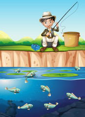 A man fishing at the pond