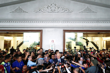 Malaysia's former Prime Minister Najib Razak speaks to journalists as he leaves a court in Kuala Lumpur