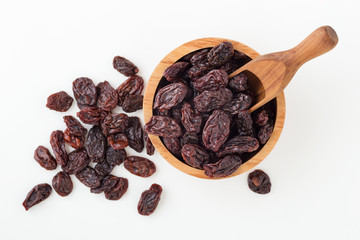 Jumbo raisins in wooden bowl