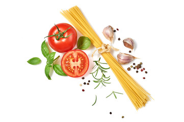 Spaghetti with tomatoes garlic and basil isolated on white background. Top view.