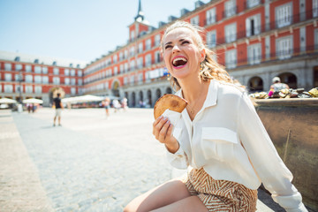 traveller woman in Madrid, Spain with Empanada at Plaza Mayor