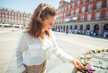 tourist woman at Plaza Mayor viewing love locks