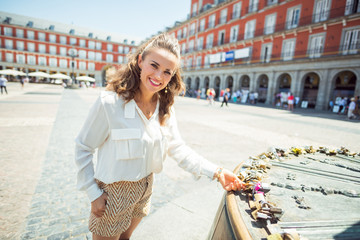 happy woman at Plaza Mayor in Madrid, Spain viewing love locks