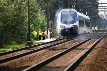 """Damage is seen at a train near the scene where a """"cargo bicycle"""" was hit which is popular with Dutch parents to transport their children at the city of Oss"""