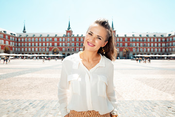 happy woman at Plaza Mayor in Madrid, Spain sightseeing