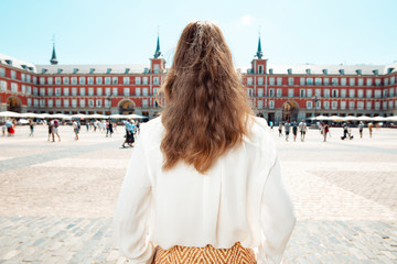 tourist woman at Plaza Mayor and exploring attractions