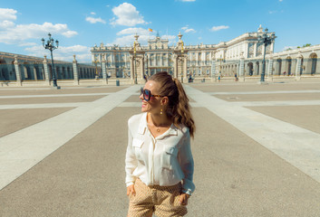 traveller woman near Royal Palace looking into distance
