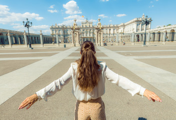young tourist woman rejoicing against Royal Palace