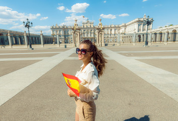 happy traveller woman with Spain flag looking into distance