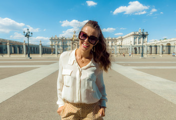 happy modern tourist woman in front of Royal Palace