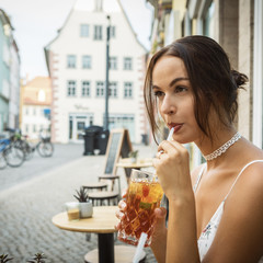 young brunette woman having ice tea
