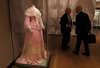 Empress Alexandra Fyodorovna's maternity dress is seen on display at the exhibition, The Last Tsar: Blood and Revolution at the Science Museum in London
