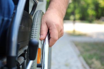 Senior man in wheelchair outdoors, closeup