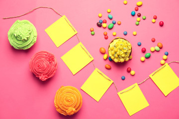 Delicious birthday cupcakes on color background