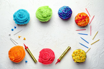 Delicious colorful cupcakes with candles on white background
