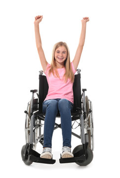 Happy teenage girl in wheelchair on white background