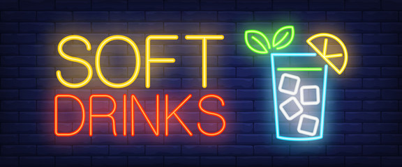 Soft drinks neon sign. Glass of lemonade with ice cube on brick wall background. Vector illustration in neon style for family cafe and restaurant