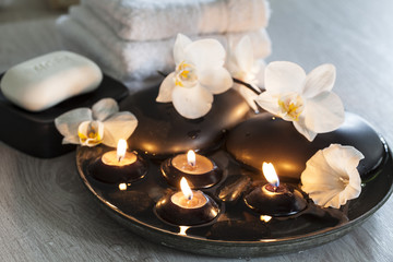 Decorative still life with soap, towels, orchid flowers and candles, perfect for spa, well-being,...