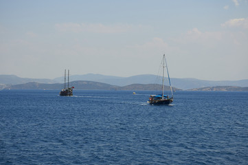 Water excursion in Turkey. Two ships diverge in the Sea. Blue sea and. Coast of the Aegean Sea. Turgutreis , Bodrum.mountains.