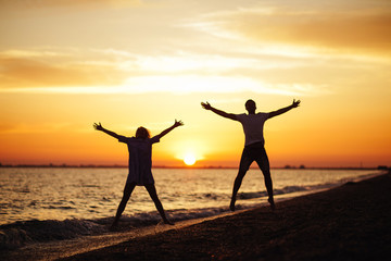 Young happy couple on seashore.