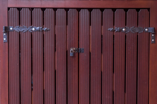 wooden doors with a lock and awnings.