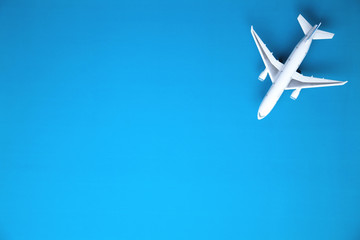 Airplane on blue background. Travel concept