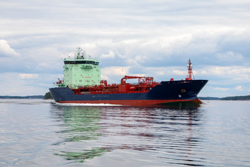 Tanker ship leaves Turku heading into the smooth Baltic Sea and Archipelago National Park (Skärgårdshavet nationalpark), Finland