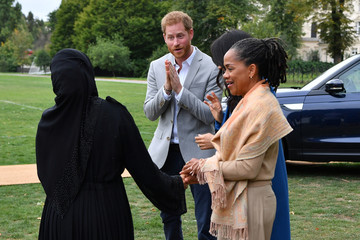 Meghan, Duchess of Sussex arrives with her mother, Doria Ragland and Britain's Prince Harry, Duke of Sussex to host an event to mark the launch of a cookbook with recipes from a group of women affected by the Grenfell Tower fire at Kensington Palace