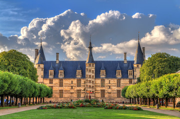The 15th century historical monument Ducal Palace of Nevers (Palais ducal de Nevers) is the first of the river Loire's castles with its renaissance façade surrounded by the polygon turrets Wall mural