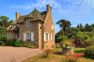 Zelfklevend Fotobehang Europese Plekken Beautiful view of a traditional French country house in Brittany, France, in summer with a blue sky
