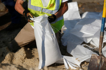A worker of Sumter Utilities fills sand bags for a building in anticipation of flood waters in the aftermath of Hurricane Florence now downgraded to a tropical depression in Conway