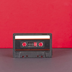 Black retro audio cassette with striped paper label