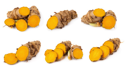 Foto op Plexiglas Kruiderij Cutting of turmeric roots isolated on white background