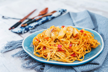 asian food chicken noodles on the table