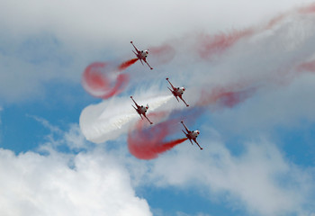 Turkish Stars, the aerobatic team of the Turkish Air Force, fly their Northrop F-5 Freedom Fighters during Teknofest airshow over the city's new airport under construction in Istanbul