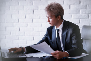 Young Asian businessman in white shirt and tie