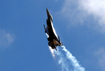 An F-16 aircraft of the Turkish Stars aerobatic team of the Turkish Air Force performs during Teknofest airshow over the city's new airport under construction in Istanbul