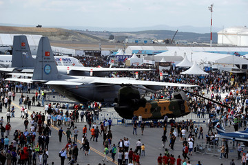 People attend Teknofest airshow at the city's new airport under construction in Istanbul