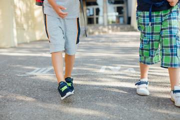 Two boys leaving school