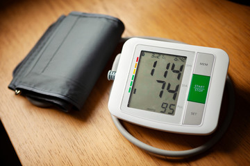 Blood pressure monitor, wth normal blood pressure reading of 114/74
