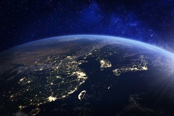 Asia at night from space with city lights showing human activity in China, Japan, South Korea, Hong Kong, Taiwan and other countries, 3d rendering of planet Earth, elements from NASA