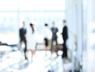 Obraz blurred image of business people standing in office.business background - fototapety do salonu