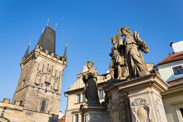Statue of Holy Savior with Saints Cosmas and Damian detail on Charles Bridge, Prague, Czech Republic