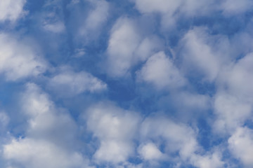 background - blue day sky with white cirro-cumulus clouds