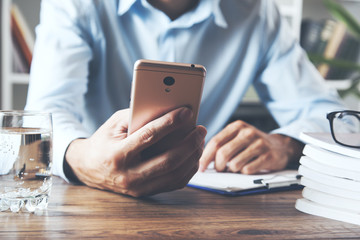 businessman working hand phone and document