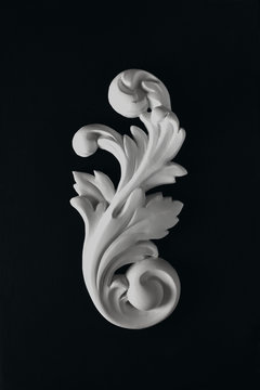 White stucco acanthus  leaf on a black background.